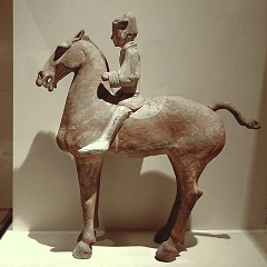 A Western-Han painted ceramic mounted cavalryman from the tomb of a military general