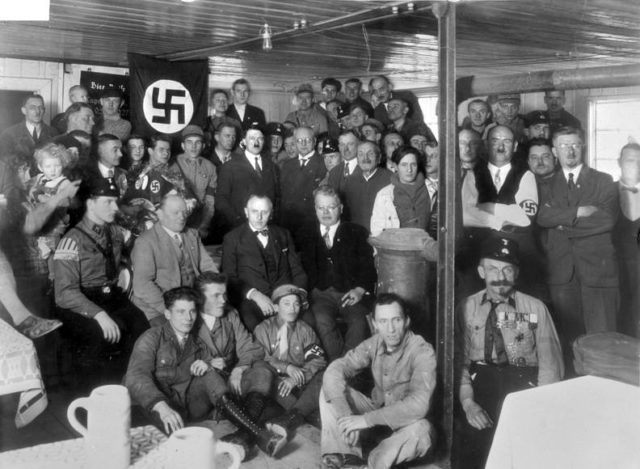 Hitler-with-nazi-party-members-in december-1930